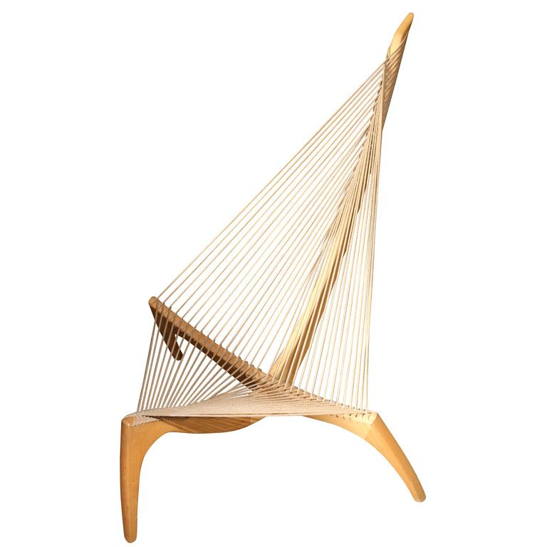 "The Harp Chair by Jorgen Hovelskov, 1966: The 'Harp"" form was inspired by the  he bow  and halyard of a Viking ship."