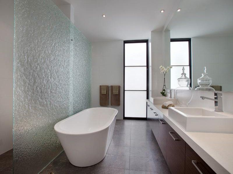Textured Glass Wall Adds Privacy To The Shower And Toilet