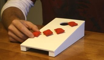 Tabletop Cornhole, or Mini Cornhole Boards are perfect to play right at your table when the weather isn't cooperating.