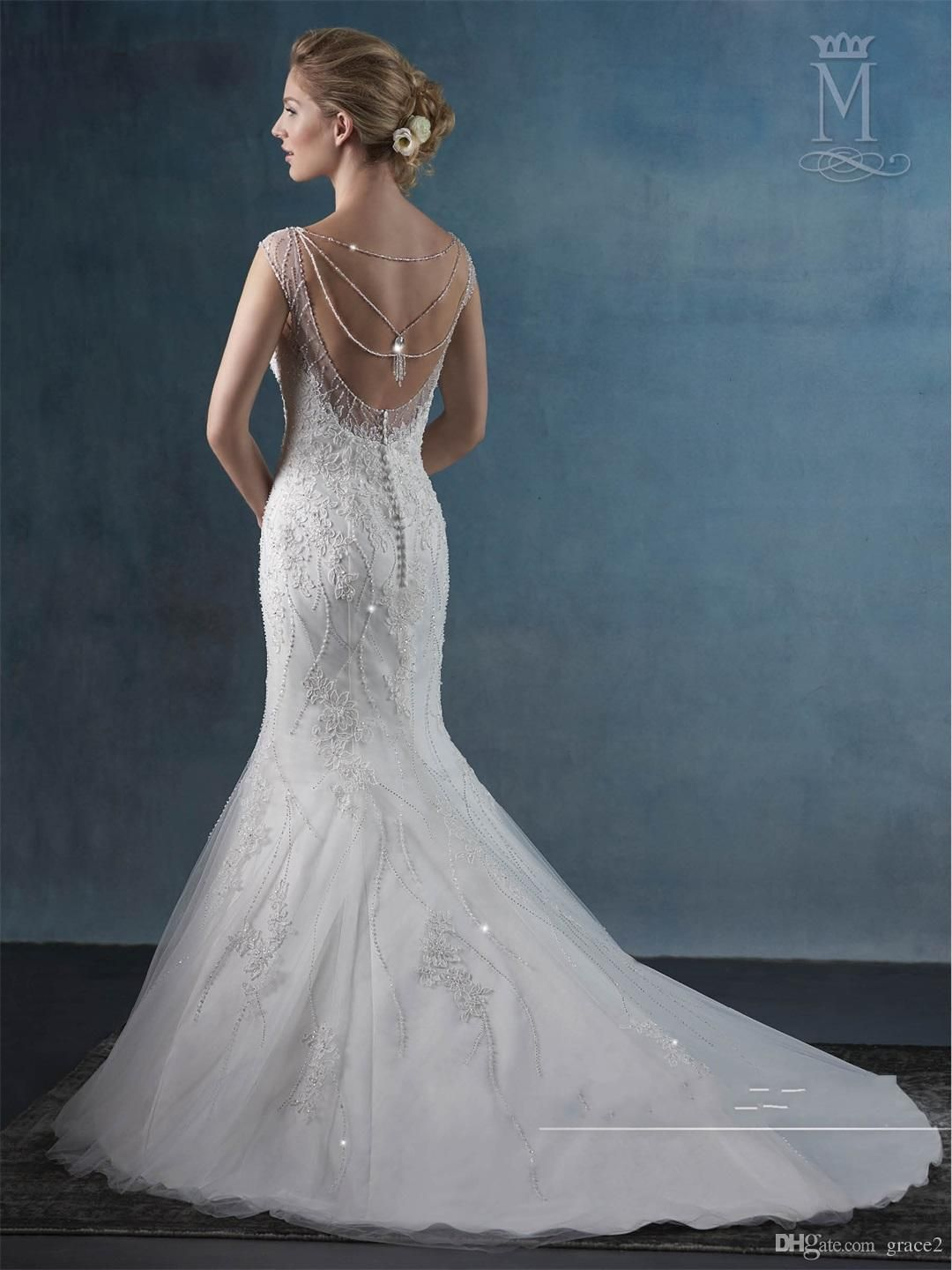 Unique Back Wedding Dresses 2017 Marys Bridal With Sheer Neck And Chapel Train Beading Chain Fit