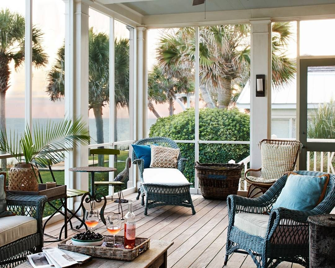 Coastal Screened Porch With Slate Blue Painted Wicker