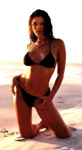 With her slim body and Dark brown hairtype without bra (cup size 32B) on the beach in bikini