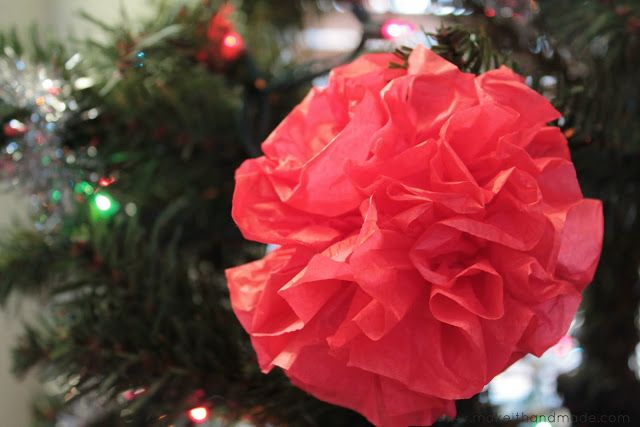 Easy Paper Pom Pom Ornament Tutorial by Make It Handmade. It only takes 2 dollars and 20 minutes to fill your tree with color!