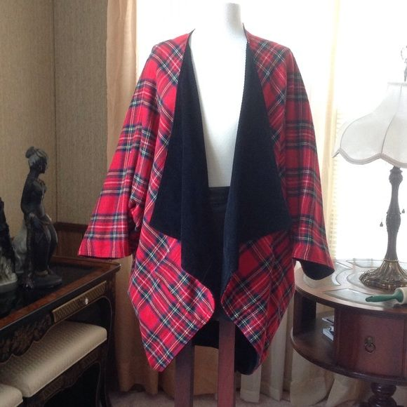 Reversible plaid jacket It has no front closure. The black side is made of corduroy material.  Both sides has front pockets.                                e Jackets & Coats