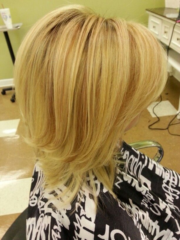 Beautiful fall haircolor. Blonde highlights with red gold lowlights. Blown out with a large barrel round brush. Perfection!
