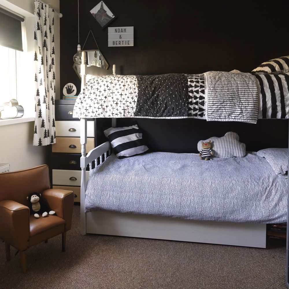 Modern monochrome boys' room with bunk beds and black wall