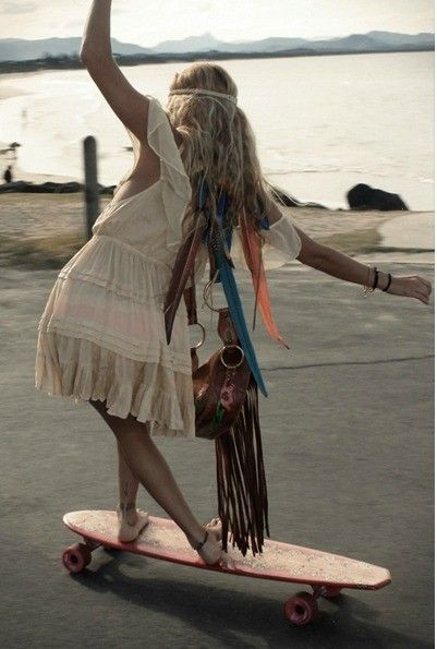 """I filed this under the category of """"Whimsy"""" because one could only longboard with garments flowing everywhere while weighted on one side in some kind of fairy land (at least, I couldn't longboard with all that stuff in the way, at my current skill level). But the photo is cute. :)"""