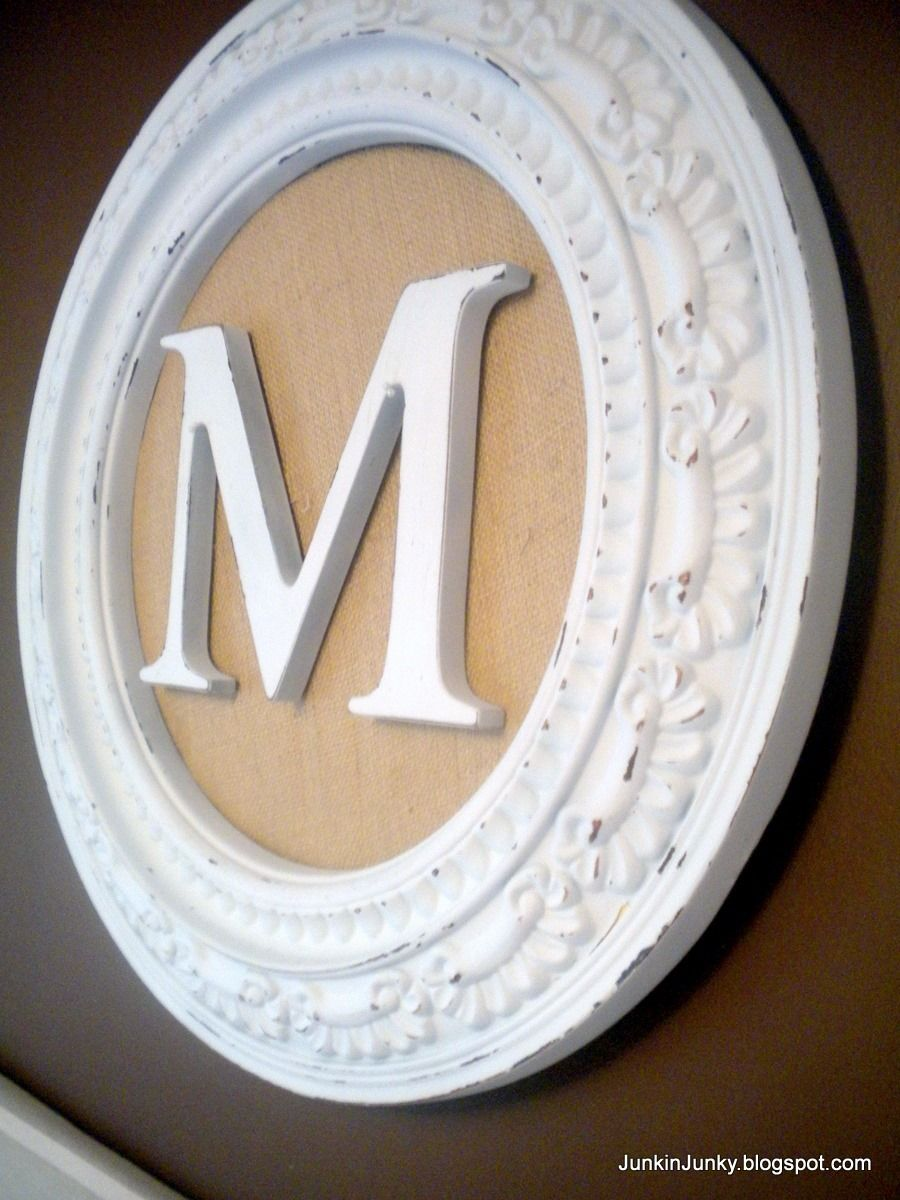 Monogram-All you need is a cute frame (or ceiling medallion), burlap or decorative fabric, and your initial. Neat for an entryway with last name initial!