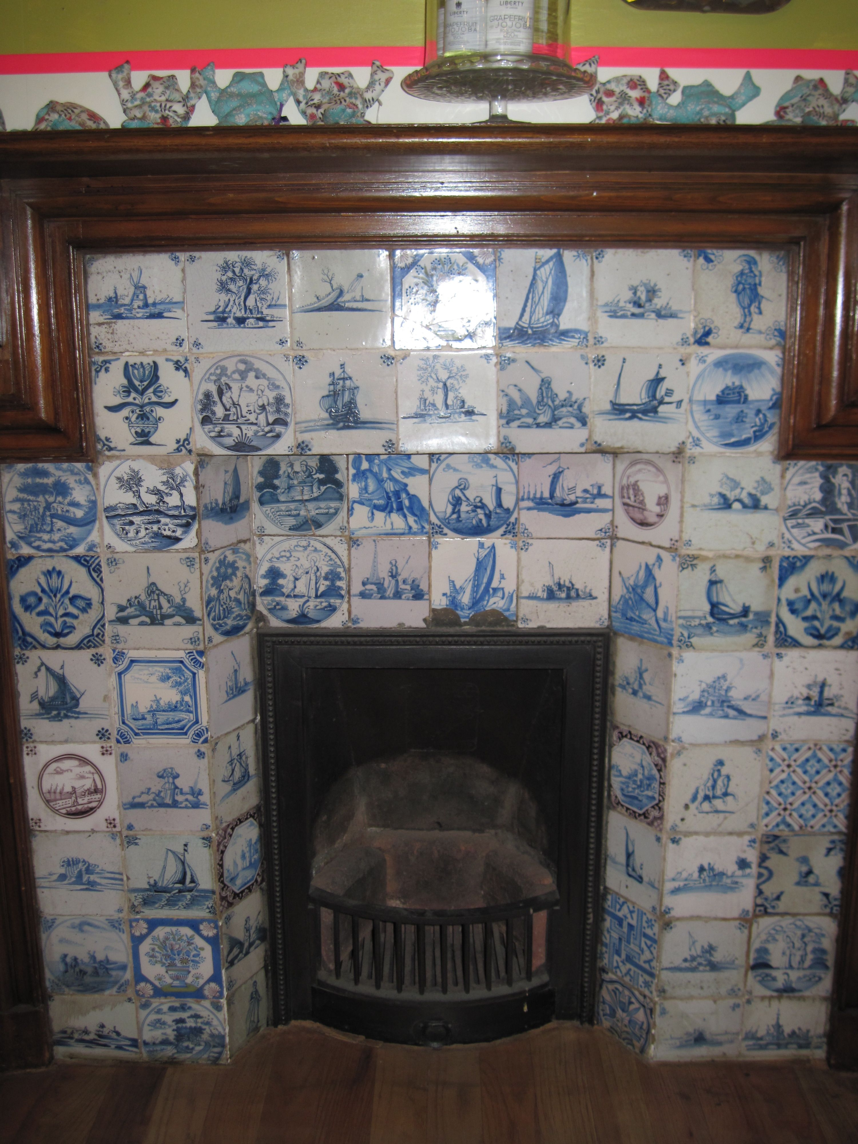 dutch delft tiles around a cozy fireplace for the home