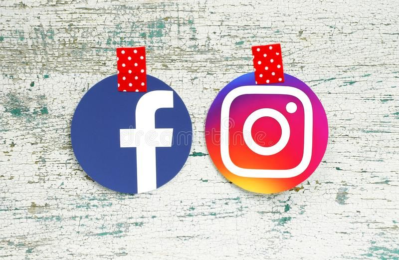 Facebook and Instagram round icons taped with red in white