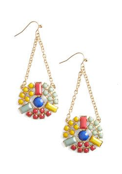These elegant earrings featuring vivid stones and gold chains echo Fridas jewelry. #modcloth #styleicon