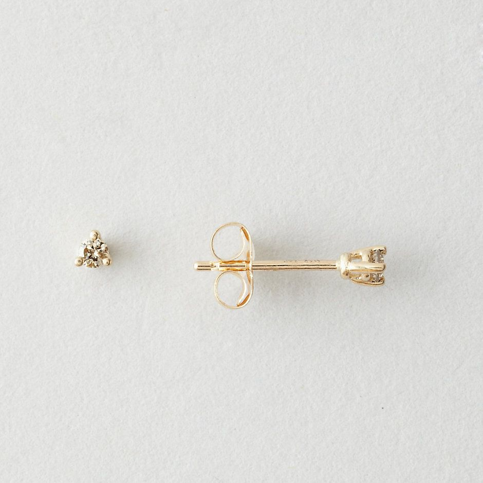 trimmed freeform set champagne stud prong faceted pave plated halo pin gold and diamond