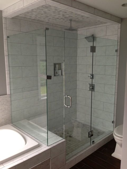 The Large Shower Enclosure Benefits From Glass To Glass Hinges Eliminating The Need For A Header Rail Frameless Eur With Images Glass Enclosure Large Shower Glass Hinges