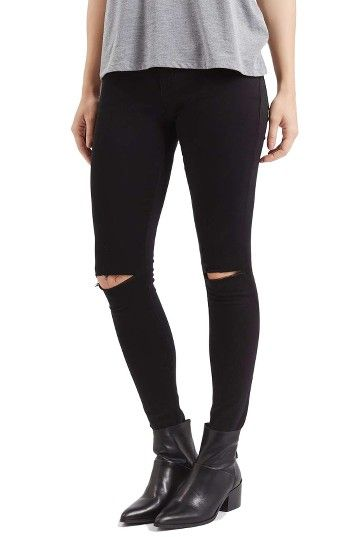 d602b02c502 Free shipping and returns on Topshop Moto Leigh Ripped Skinny Jeans at  Nordstrom.com. Mid-rise skinny jeans in a black wash are shredded at the  knees and ...