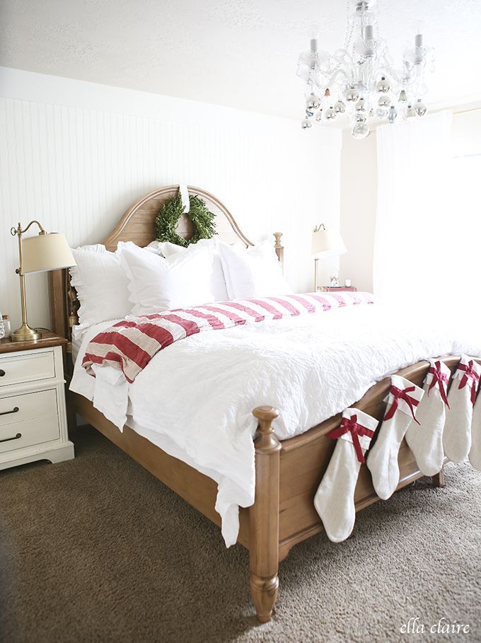 Take your white bedding and for one night add a red & white striped blanket (or a favorite Christmas colored blanket) fold down, matching stockings and a wreath... Voila Merry Christmas!