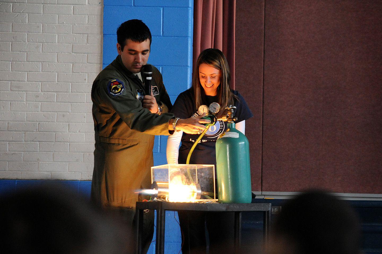 Air Force Cadet Victor Lopez demonstrates a hybrid rocket