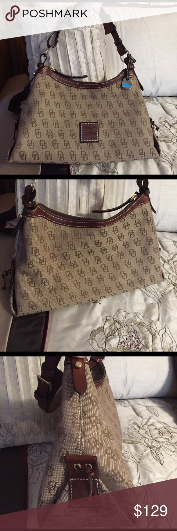 Dooney & Bourke Shoulder Bag Brown monogram, brown leather and goldtone accents. Preloved, but in great condition. Dooney & Bourke Bags Shoulder Bags