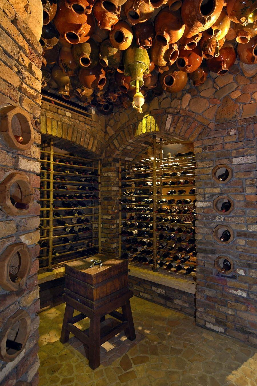 Amazing Wine Cellar With A Unique Ceiling Covered In Clay Jars