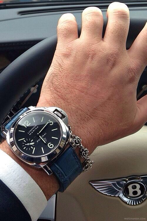 Panerai Luminor Marina 005 on a blue alligator strap from Simona Straps paired with a silver rose motif bracelet from King Baby Studio.