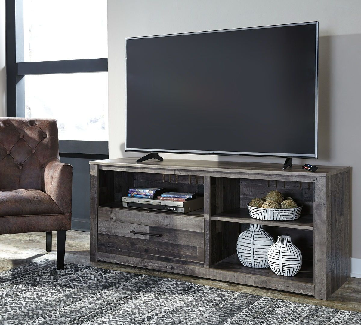 The Derekson Multi Lg Tv Stand W Fireplace Option Available At United Furniture Ser Large Tv Stands Entertainment Center Furniture Home Entertainment Furniture
