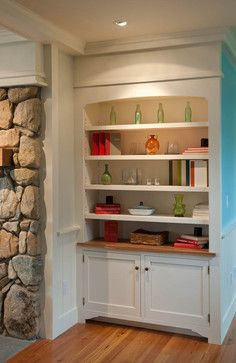 built in bookshelves in the living room offer places for sea inspires accessories in
