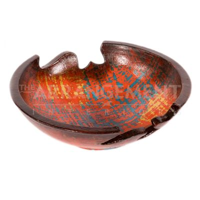 Sculptural Bowl Pottery  An exquisite handmade pottery piece that is a unique and traditional work executed in a modern style. Bring style and elegance to your home with this orange, blue, and yellow patina sculptural bowl that can display as an individual piece or display items inside.