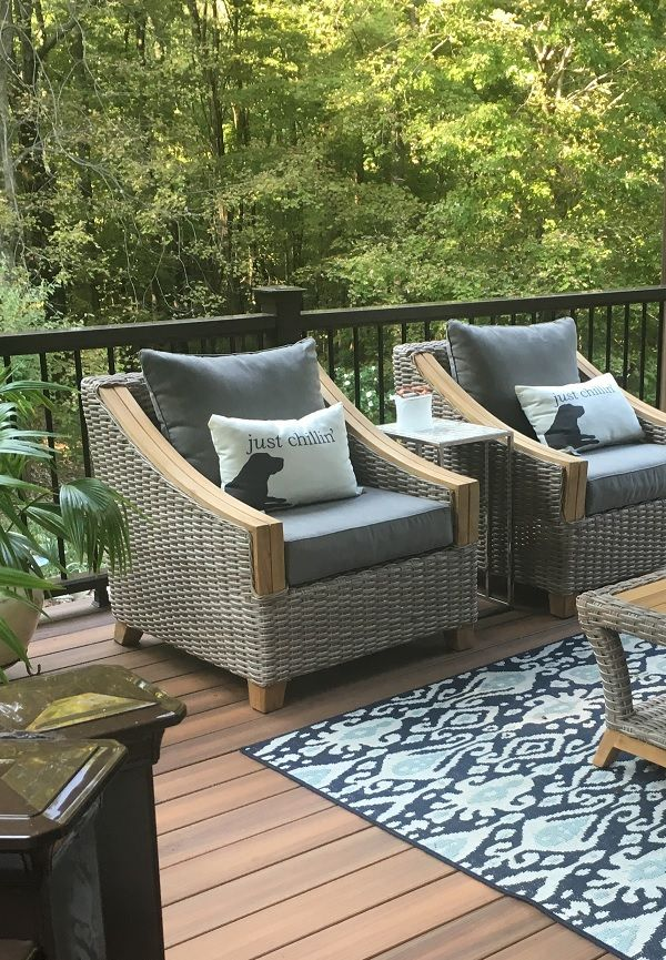 Cozy Outdoor Furniture And A Bold Patterned Rug Set The Stage For This Warm And Inviting Deck S Outdoor Rugs Patio Outdoor Furniture Sets Outdoor Living Space