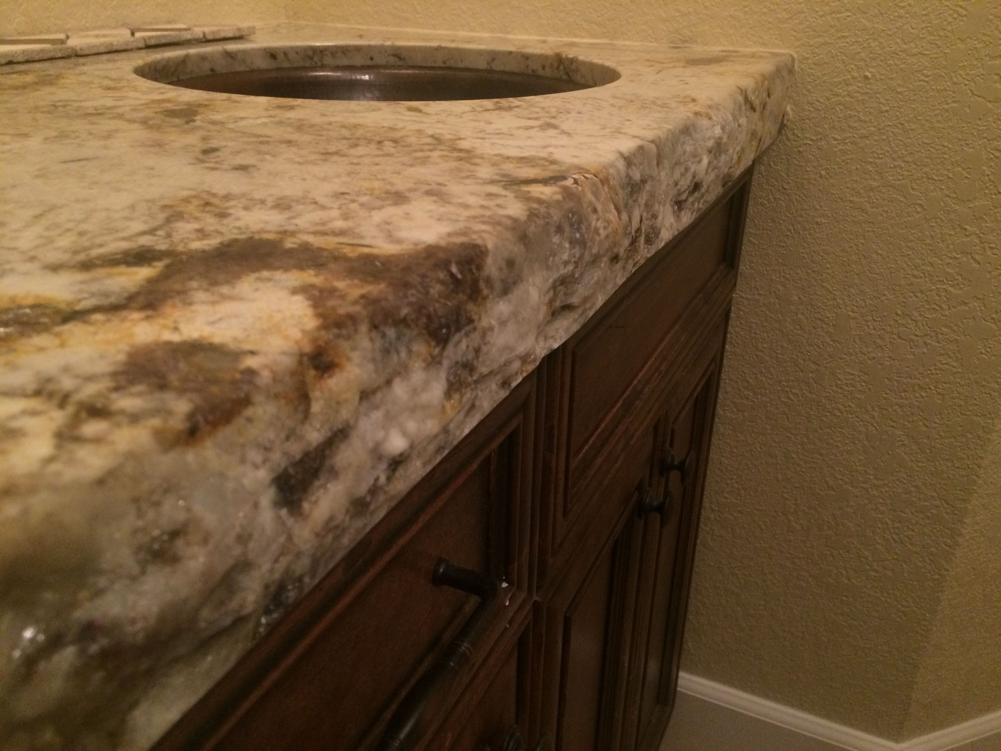 granite and cooper with thick chiseled edge counter tops