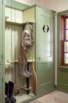 green mudroom cabinets | Green mudroom with fishing gear storage -- Ashley Campbell Interior ...