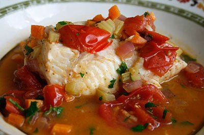 Fish in Crazy Water, from Cuisine at Home Magazine. This reproduction of the recipe has a lot of mentions of a specific wine. For heaven's sake, use whatever wine you want. I've made this with cod, and it's delicious and just as good the next day as a lunch leftover. The combination of olives, capers, and tomatoes create a great broth.