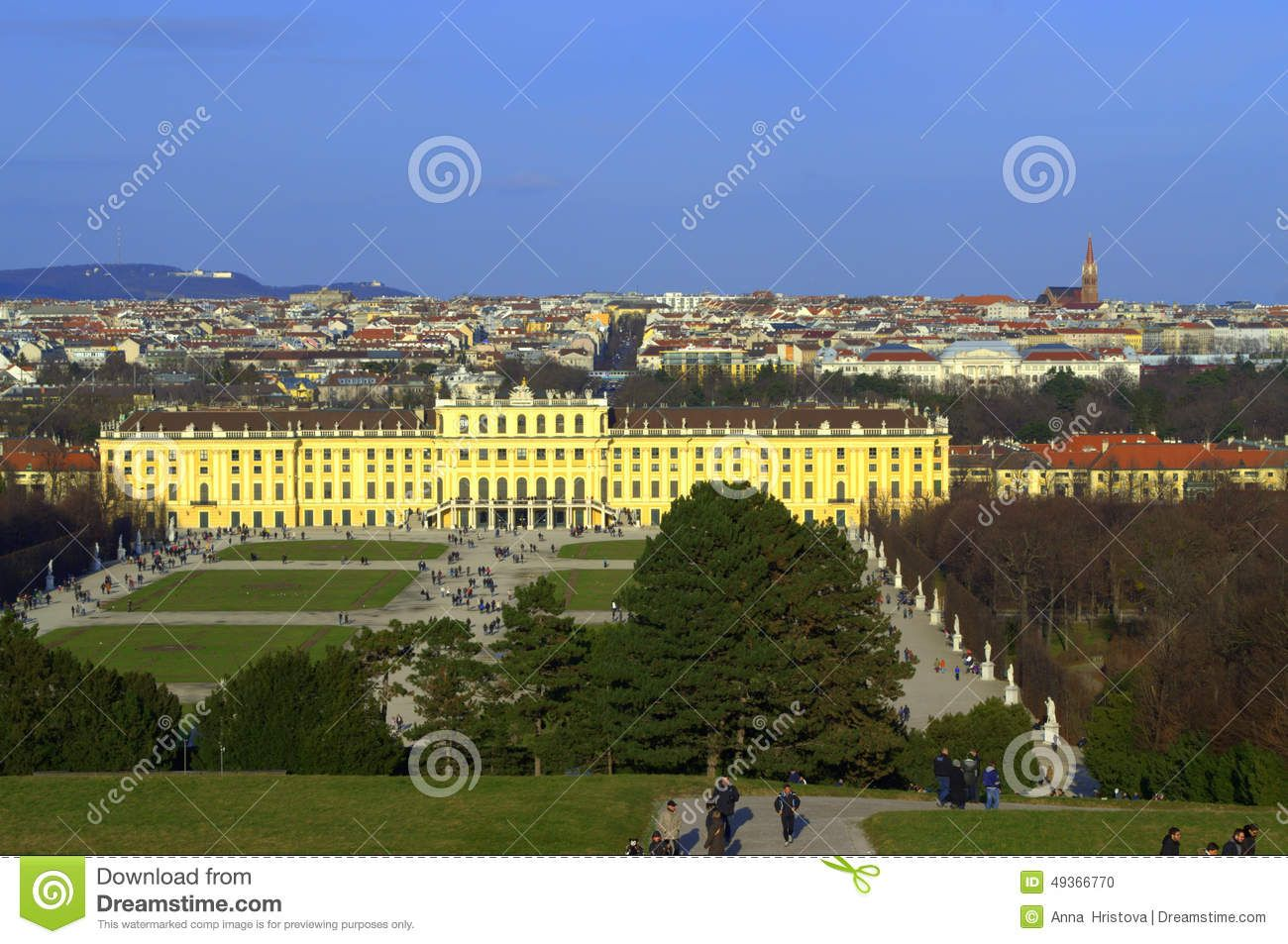 Beautiful scenic view and people sightseeing at bright  winter day  in Schonbrunn Palace garden and pond in Vienna, Austria