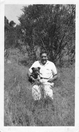 Black and White Vintage Snapshot Photograph Man Hugging Dog Field 1950's
