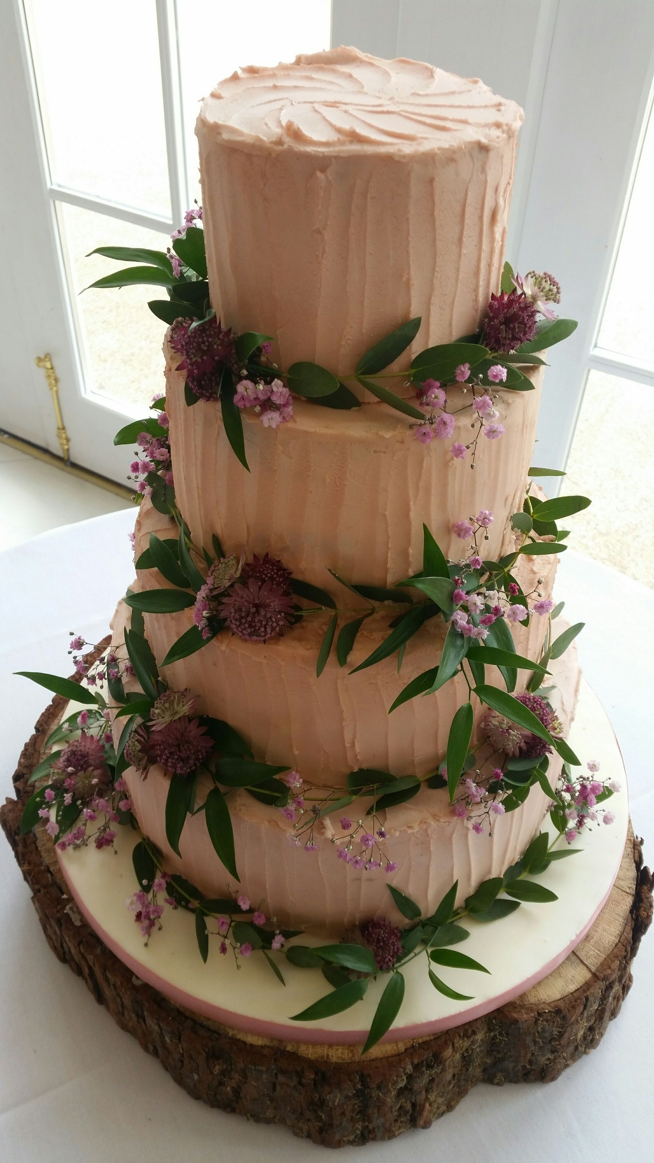 Vintage Pink buttercream frosted wedding cake decorated ...