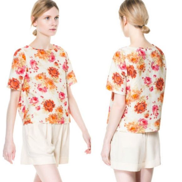 """NWOT ZARA Woman Printed Floral Jacquard Top Everyone who has seen this shirt in my closet has gone """"Oh, what a great vintage top!"""" IT LOOKS vintage, dudes. It has a texture to the fabric that just screams late 1960's Betty Draper. I can just see her with high waisted cropped pants and flats, big sunglasses and bigger hair. This shirt is everything you need to capture that coveted look. Also, a martini wouldn't hurt. And then maybe two more, for good measure. Says XS, but can also fit a…"""