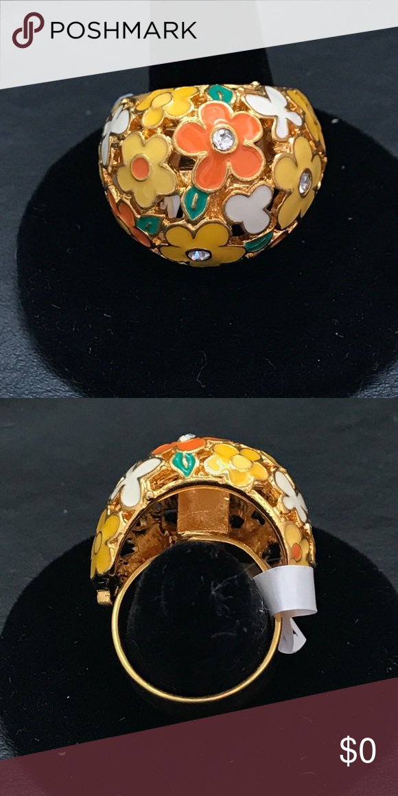 Beautiful Gold Multi Colored Flower Ring This ring is really beautiful and adjustable! It has colored flowers on it and it's brand new and never been worn!! I will give it free with a purchase of $50 or more!! Not Designer Brand Jewelry Rings