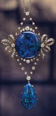 A Fine Belle Epoque Black Opal and Diamond Pendant Necklace, Circa 1900. Centering a cabochon black opal, between old brilliant-cut diamond set ribbons and frame, suspending a pear-shaped cabochon black opal drop, accented by single and old brilliant-cut diamonds by the Goldsmiths & Silversmiths Company Ltd., 112 Regent St. London, by appointment to H.M. the King.