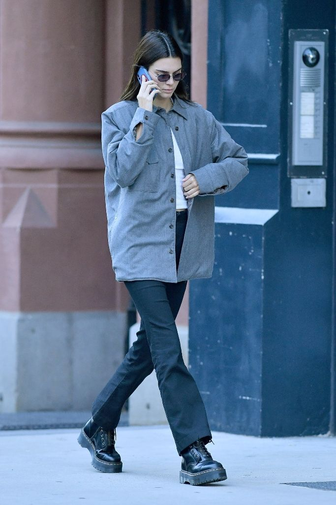Kendall Jenner Styles Zip-Up Stompers With a Low-Key Look in NYC #kendalljennerstyle Kendall Jenner wearing a gray button-up shirt with black pants an…