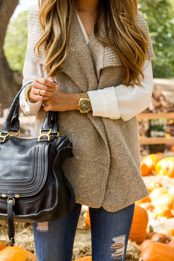 I would love a chunky sweater vest like this to layer with long ...