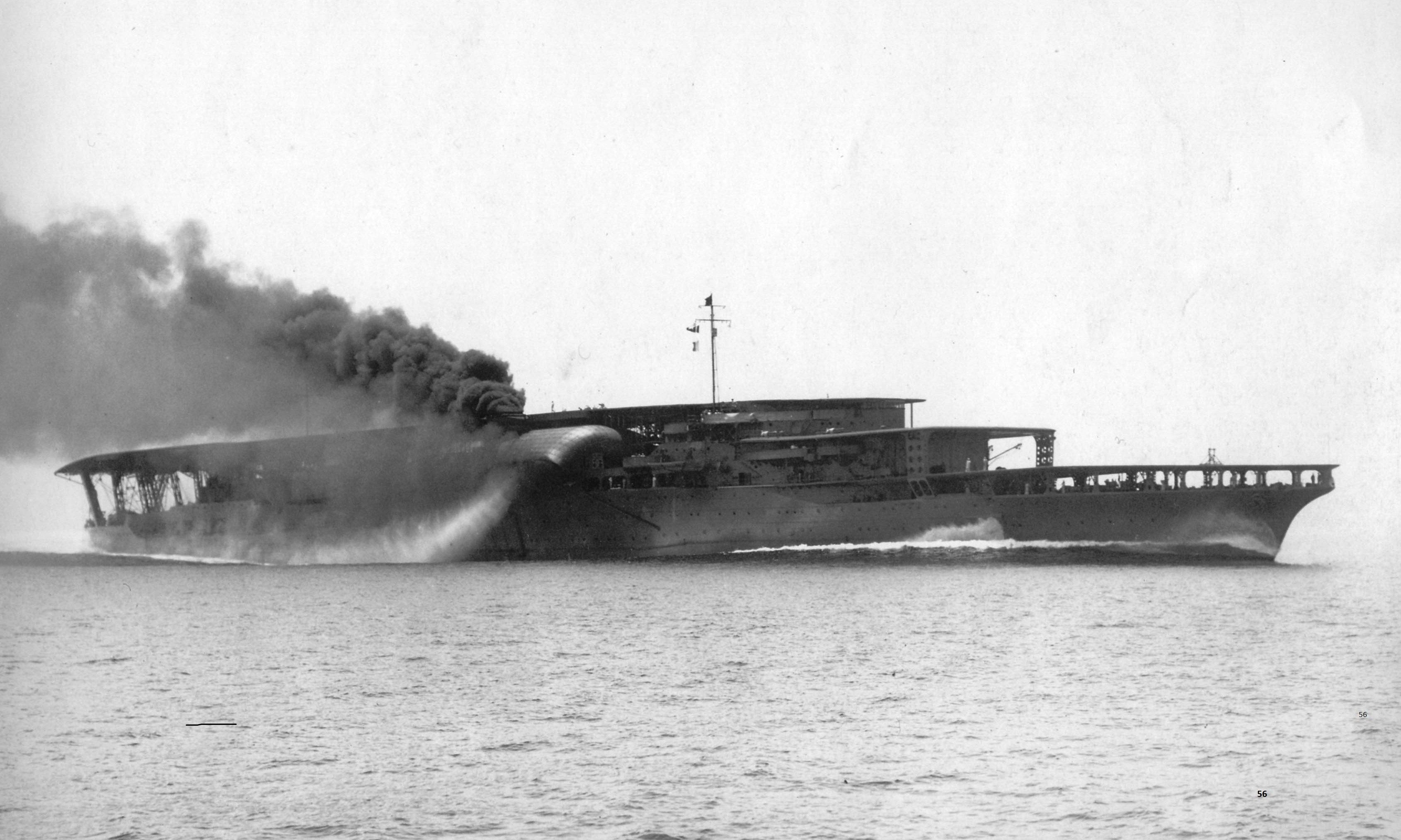 Japanese Aircraft Carrier Akagi 1931 when she had the 3 forward flight decks. Akagi rid herself of stack gases by means of one large funnel canted downward.