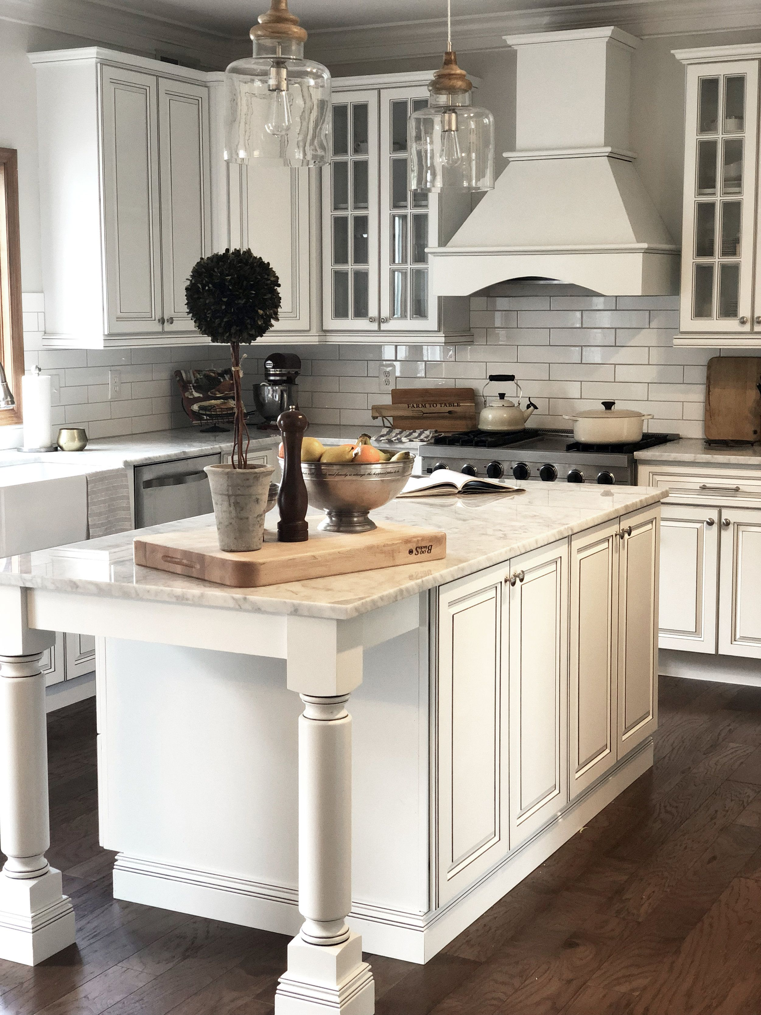 Stunning White Farmhouse Kitchen Island Complete With Glass Cabinets And Carrara Marble Countertops Major Kitchen Marble Kitchen Design Marble Kitchen Island