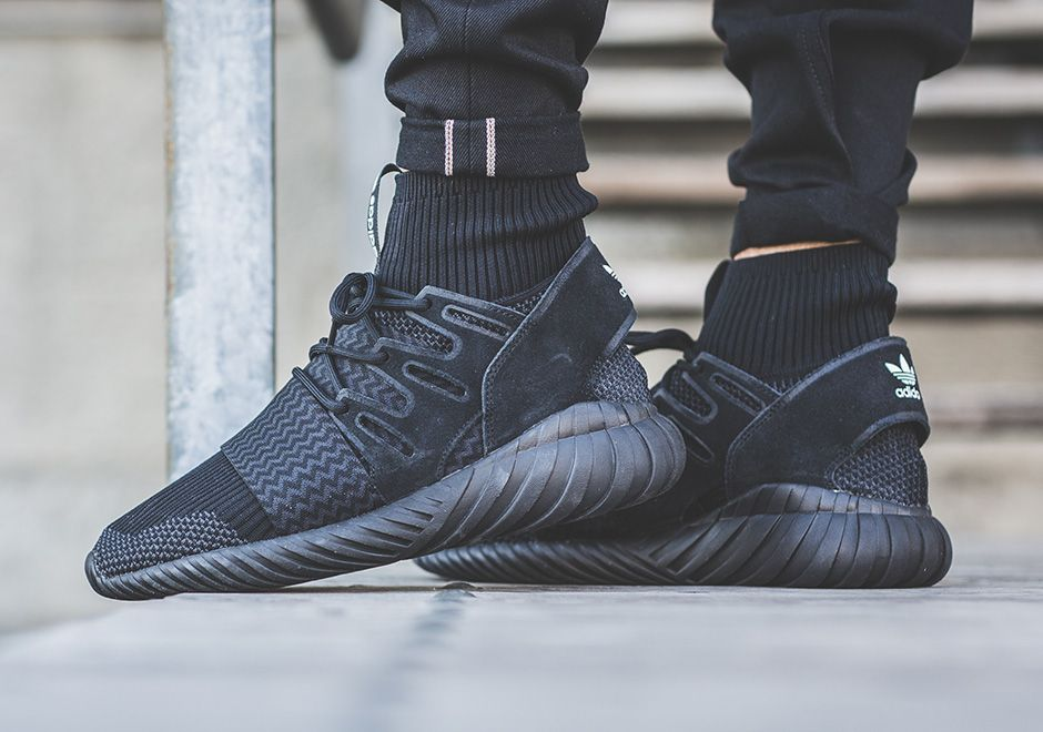 adidas Tubular Doom Primeknit Triple Black features a Core Black, Core Black  and Core Black color scheme. This adidas Tubular Doom is built with  Primeknit