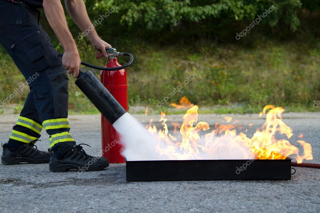 Instructor showwing fire extinguisher Stock Photo ,