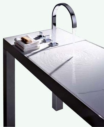Flat Sink by Alape -- seems to be merely a table but actually features a thin channel that siphons water into hidden plumbing.