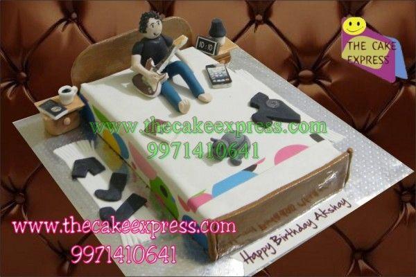 GUY PLAYING GUITAR CAKE