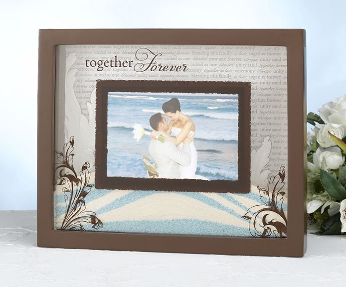 """This unity sand picture frame is designed to be used in place of a unity sand vase during the wedding ceremony, with bride and groom both filling it with sand.  The frame is resin and measures 11"""" wide, 9"""" tall and 1.625"""" deep.  The lid slides outward so you can fill it with sand and replace the photo.  Filling the frame like in the first two photos (a little under halfway) takes 24 ounces of sand.The outer frame portion is painted brown.  The inside back is engraved with various terms of…"""
