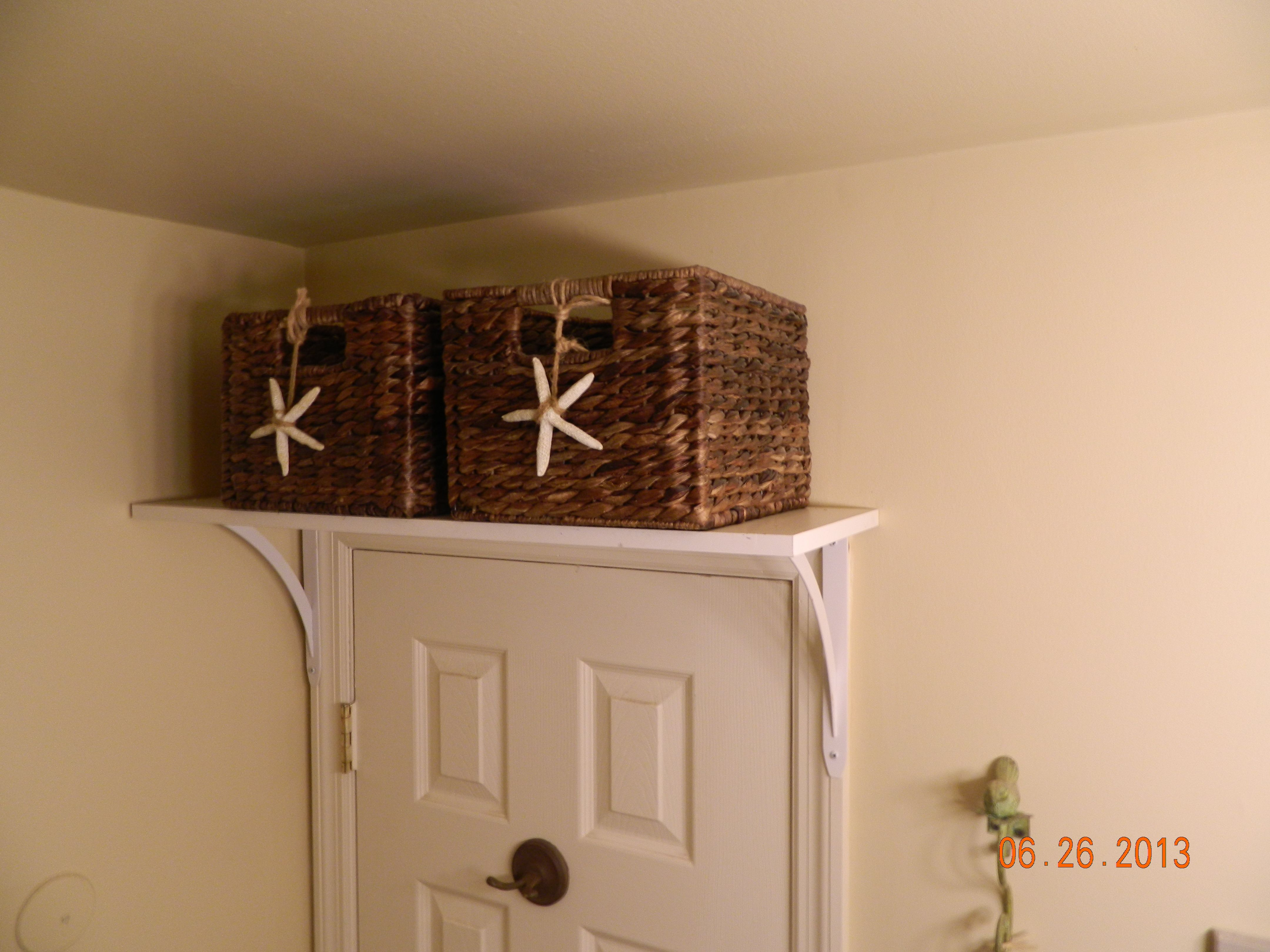 Home Depot Shelf And Brackets Attached Over Bathroom Door With