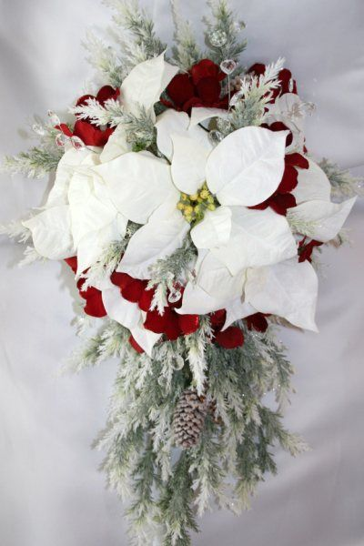 poinsettia bouquet idea for the end of the pews in the chapel