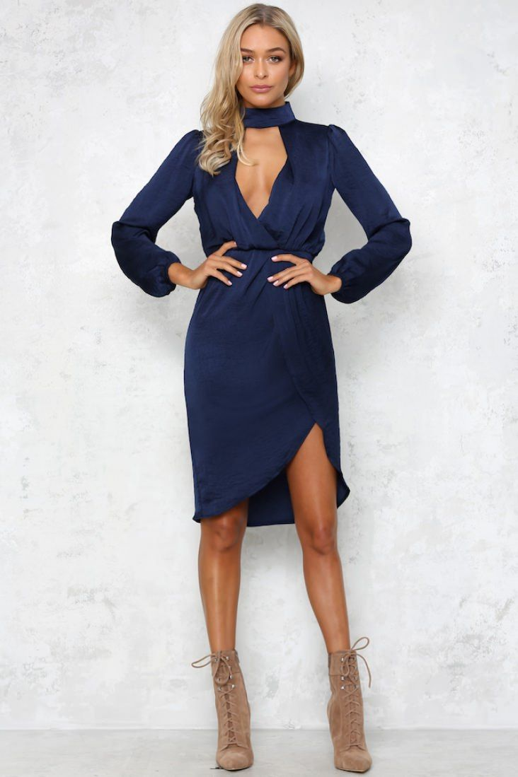 a11cbbac801 This stunning long-sleeved midi dress has a high neck