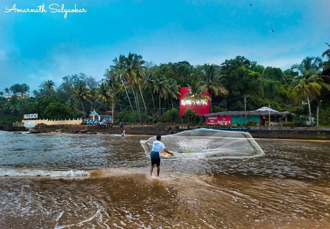 Somewhere beside the restless sea, walking side by side with heart that beats in sync with the waves . Waiting to see the fisherman flying his net.  #Fisherman #Fishing #Monsoon #Beach #Evening #Sky #Net #Waves #ScenicView #GoodTime #PickMyGoaPic #Goaexplore #Unexploredgoa #Glimpsesofgoa #SoGoa #all_about_goa #Picmygreen #Goan_igers #Colorsofgoa #Ourgoa #Stayonroad #Goaindia #GoIndia  #Beautifulgoa #_MOG #Goanstoryteller #ГОА #Baga #Goa #India