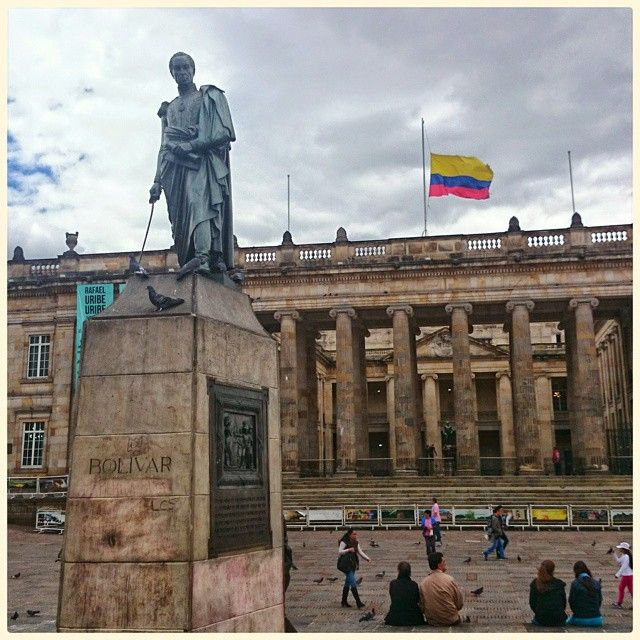 Statue of Simón #Bolívar and National Capitol in Plaza de Bolívar La #Candelaria #Bogotá #Colombia. by paolobarone